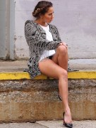 American actress and singer Adrienne Bailon suffers a wardrobe malfunction flashing her black panties while shooting an editorial in Tribeca in New York City