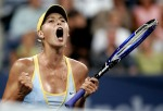 Maria Sharapova of Russia celebrates a point against Eleni Daniilidou of Greece at the U.S. Open tennis tournament in New York